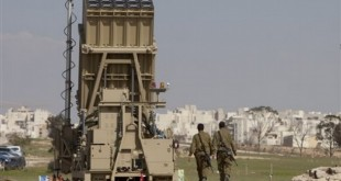 Israeli soldiers walk next to the Iron Dome, a new anti-rocket system, near the southern Israeli city of Beersheba, Sunday, March 27, 2011. Weeks of stepped-up rocket and mortar attacks have drawn fears of renewed war and led to new calls in Israel for the military to deploy the $200 million Iron Dome anti-rocket system. The Israeli military said the system began operating on Sunday near Beersheba, southern Israel's largest city. (AP Photo/Oded Balilty)