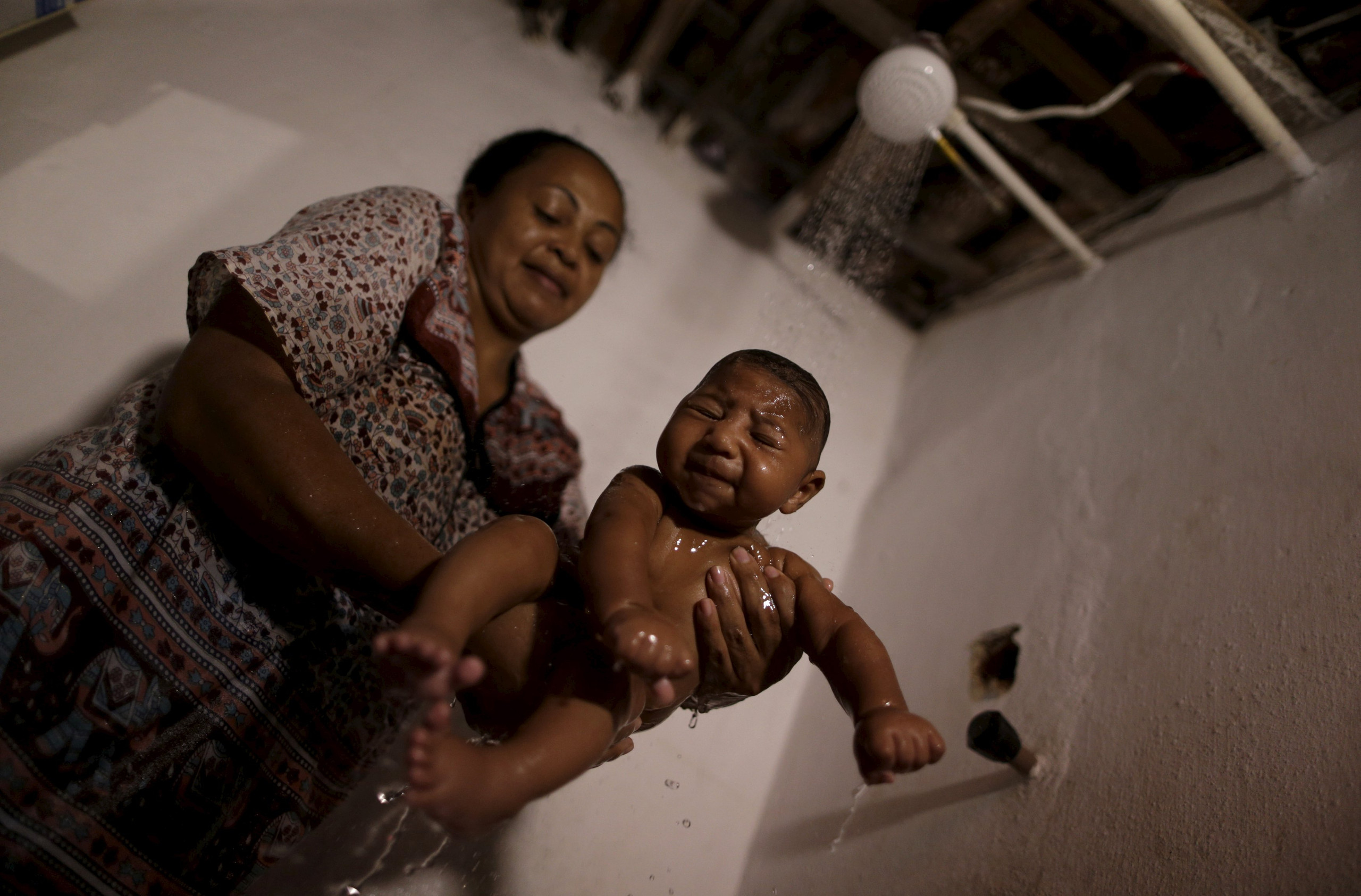 Hilda Venancio bathes her son Matheus, who has microcephaly, in Recife, Brazil